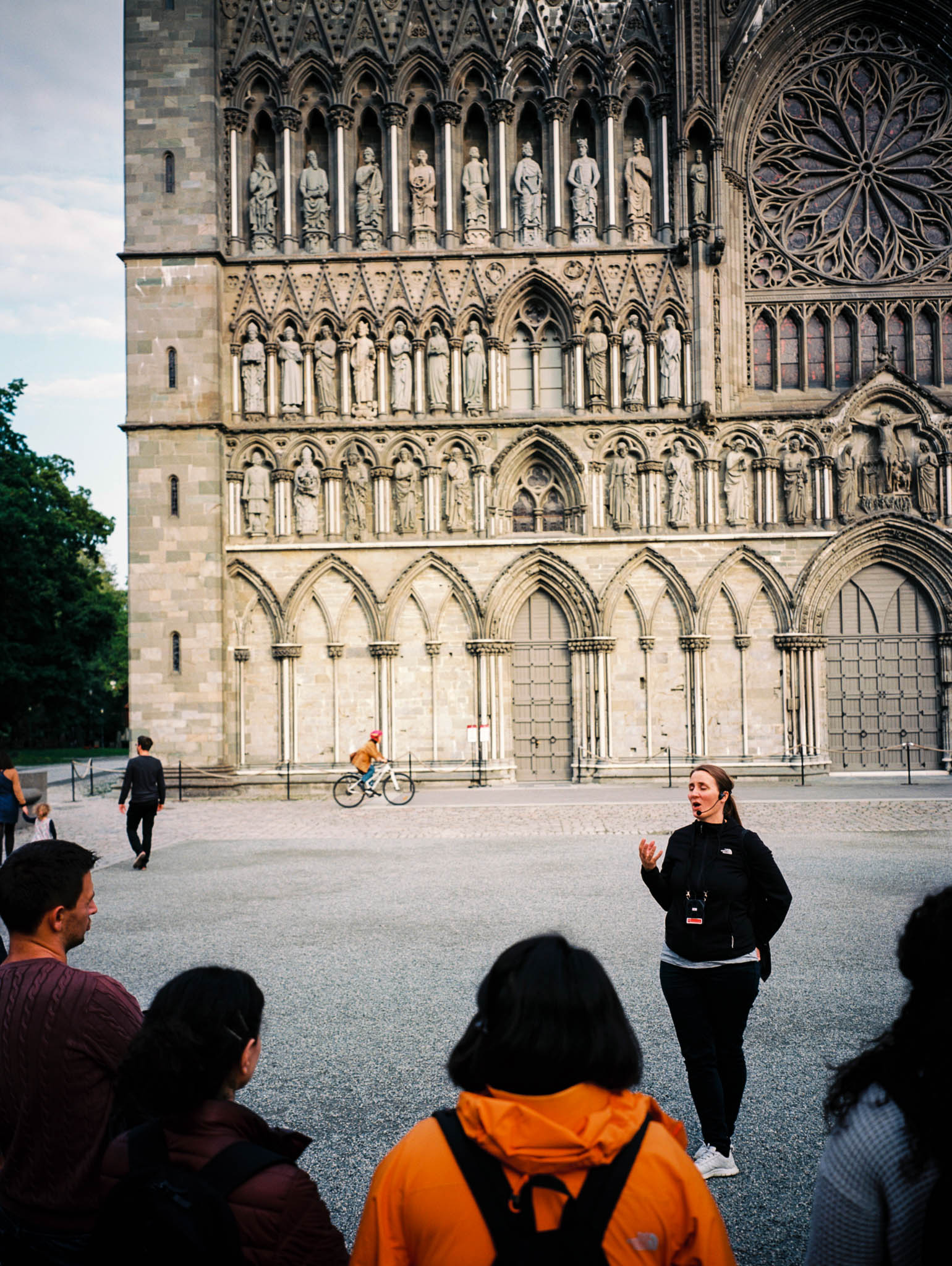 Friday 16.9.2016. Group of tourists and a guide in front of Nidarosdomen cathedral